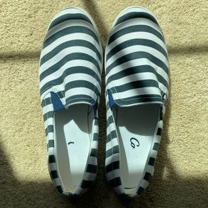 Black and white strapped slip on shoes